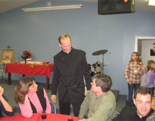 Fr. Daniel Brandenburg LC visits with families during the �Christ the King� Day celebration
