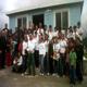 """Il gruppo di """"Famiglia Missionaria"""" dopo la benedizione della casa, edificata dai missionari in agosto 2012."""