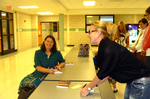 Joan talks with mothers at a book signing at Everest Academy in Clarkston, Michigan