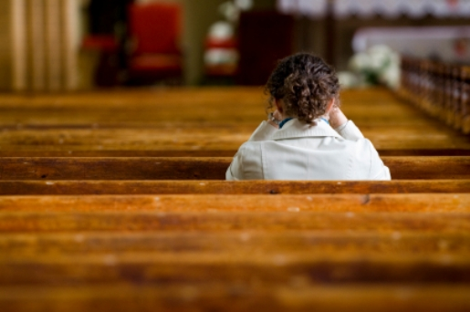 Woman praying in church