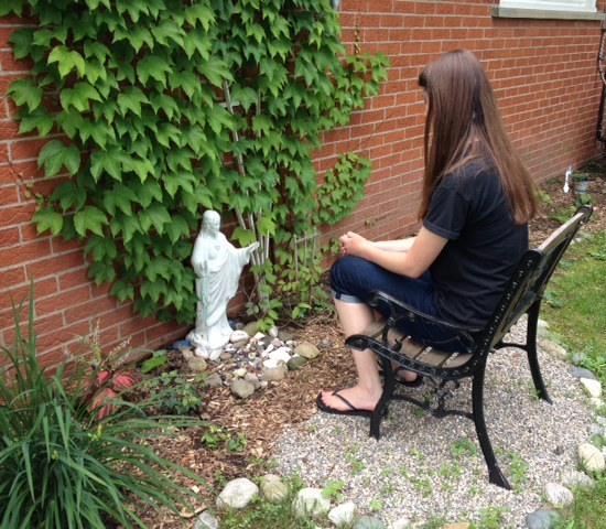 Jackie in her prayer garden