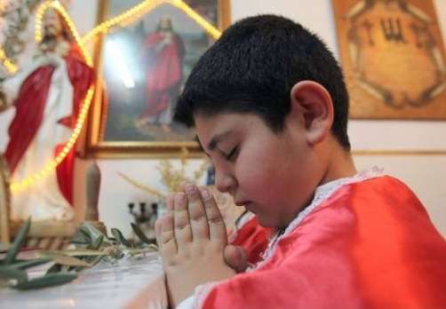 (Photo by Ali Jarekji, Reuters via CNS) Iraqi Christians like this boy fled to neighboring Jordan in recent years. IPS is partnering with seminarians in Iraq to better serve their Catholic community.