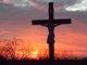 The crucifix behind St. John the Baptist parish in Colerain, Ohio, at sundown