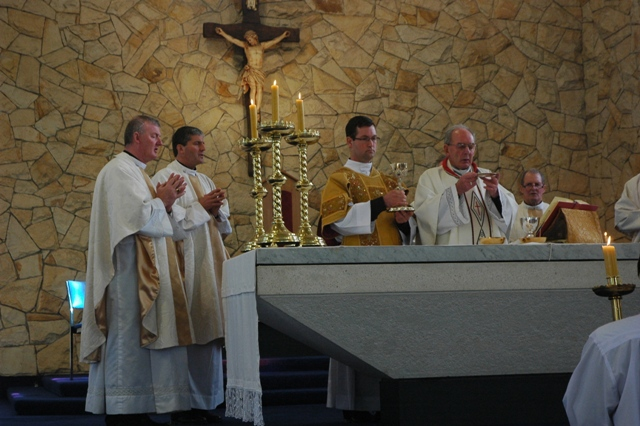Deacon David Joyce assists at Mass