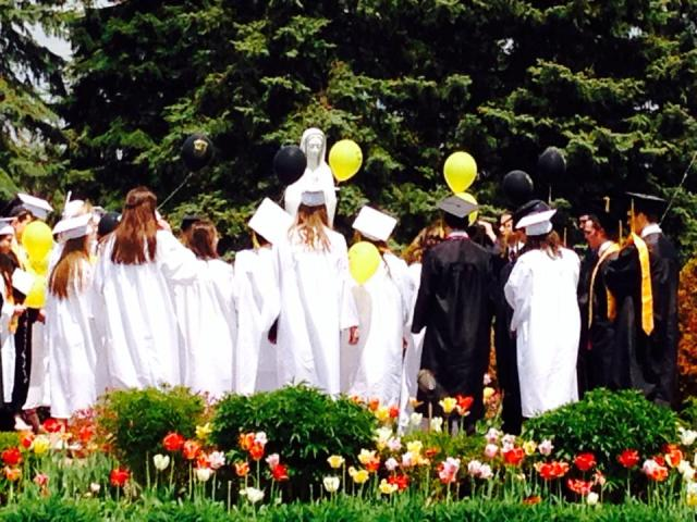 EC Graduates saying the rosary
