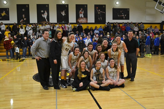 Lucia Westrick poses with her team after they won the 2014 MHSAA Division 4 championship.  She is standing, third from the left, next to her coach, Erin Van Wagoner.