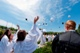 Everest graduates toss their caps after saying a final decade of the Rosary around their school&#039;s Marian shrine