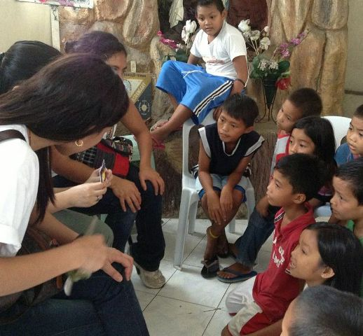 Explaing a holy card to the children
