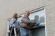 Christina Van Dorpe paints windows with her dad in Oxford