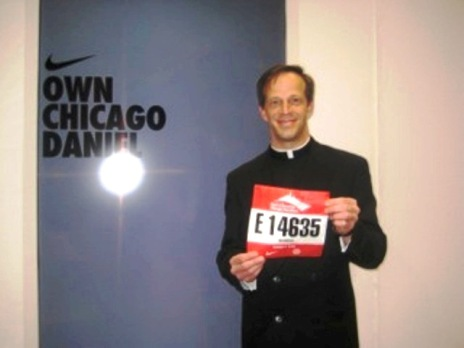 Fr. Daniel holds marathon tag