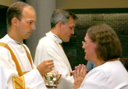 Fr. Daniel Brandenburg distributing communion