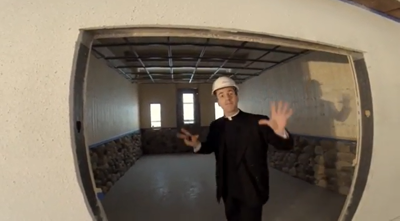 Fr. Gregory Usselmann shows off The House chapel