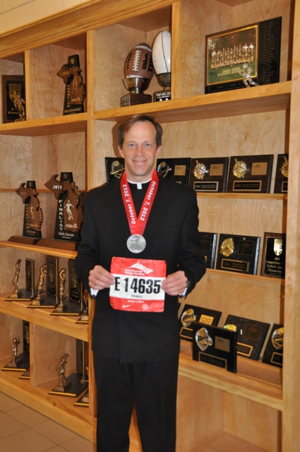 Fr. Daniel with Chicago marathon medal