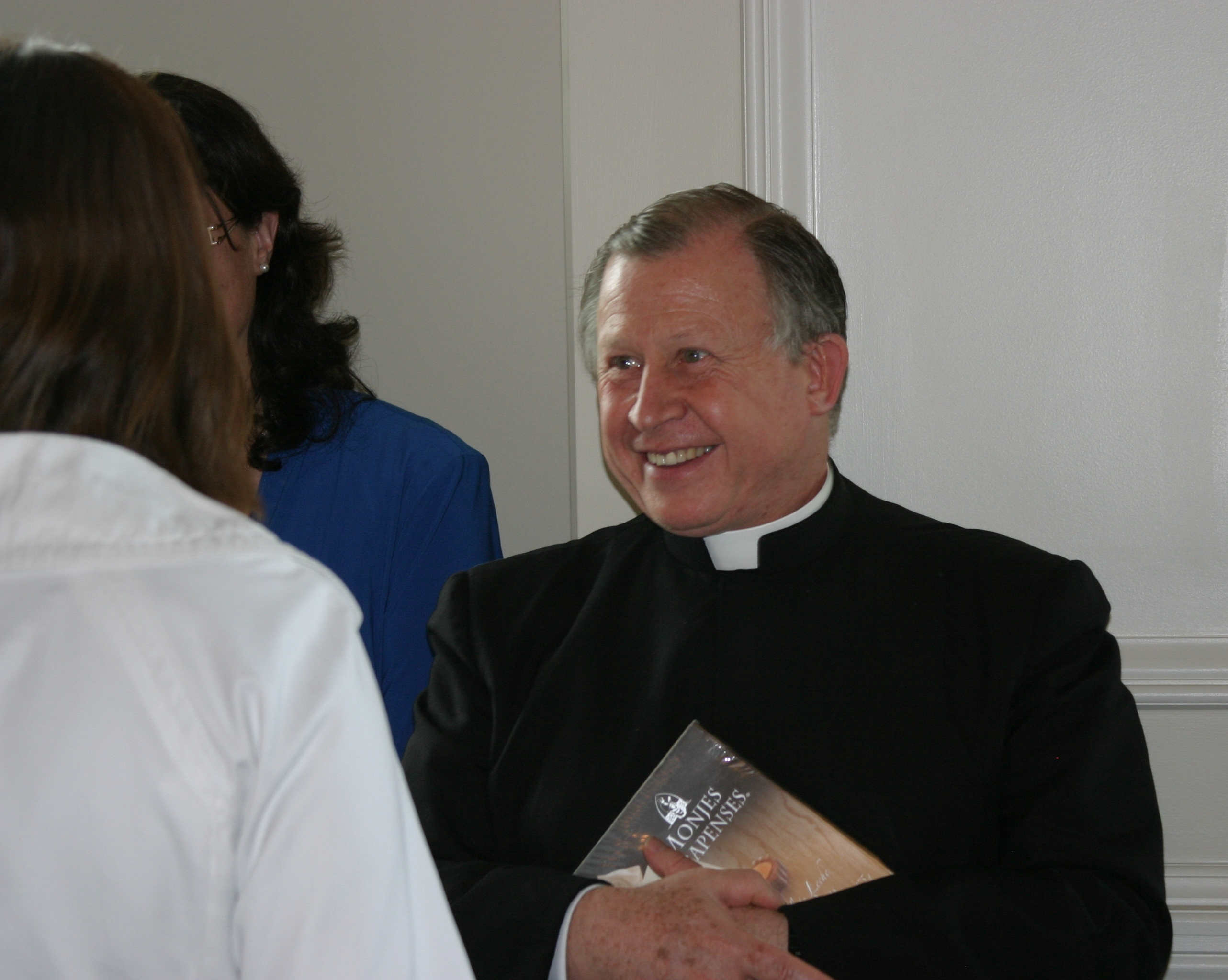 Fr. Gil talking with consecrated women
