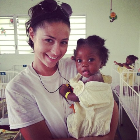 Chelsea Gheesling with a Haitian child
