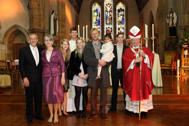 Deacon Stephen Howe LC with his family and bishop