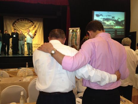 In prayer at the Cancun Summit