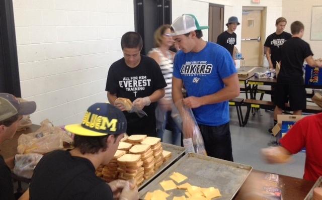 EC Football team makes sandwiches for the homeless