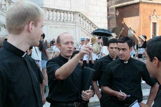 Father David Abad, LC explains St. Peter�s Square to newly arrived brothers