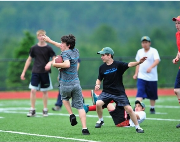 Playing football at Conquest camp