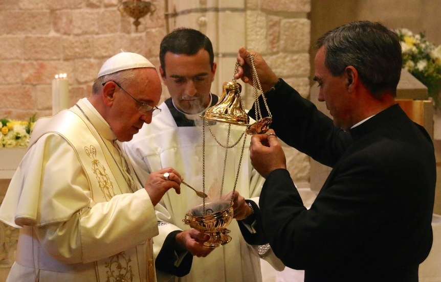 Pope Francis preparing incense