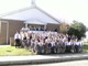 Bishop Earl Boyea with students at St. Thomas More Academy.