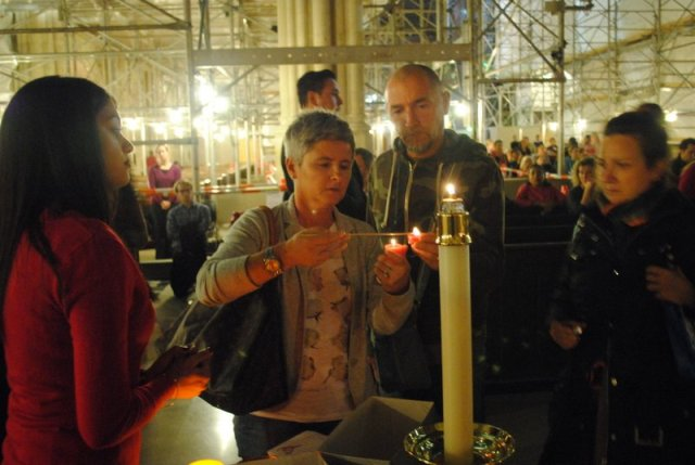 Lighting candle for prayer intentions