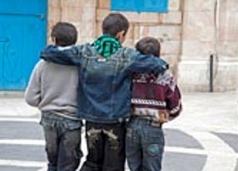 Three boys walking arm in arm