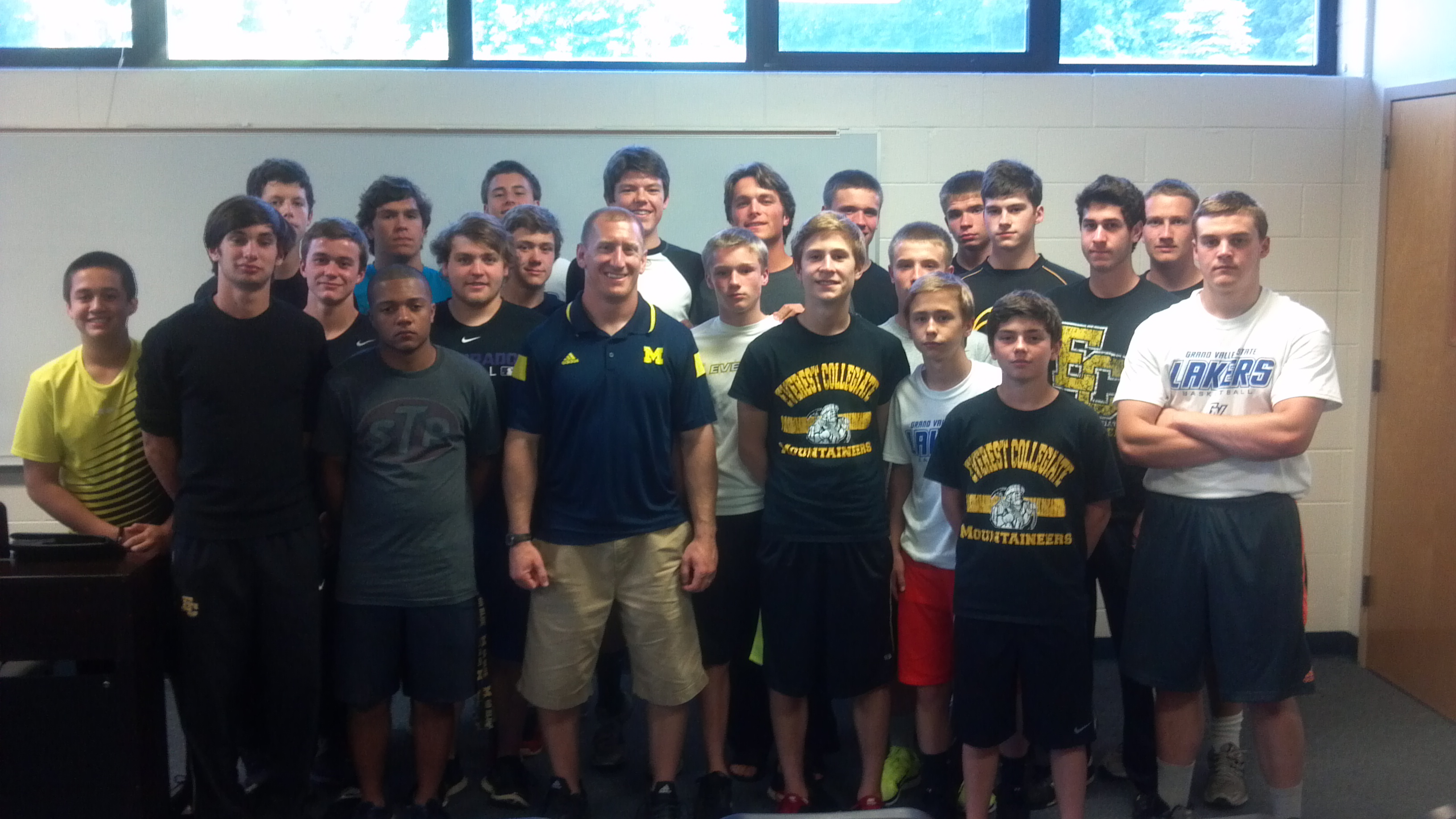EC football team with U of M speaker Lewis Caralla