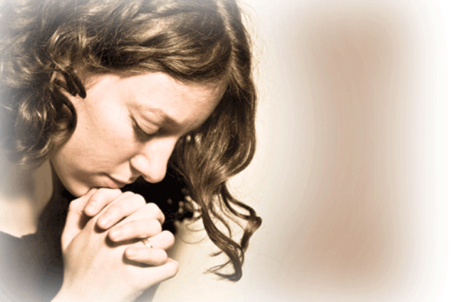 Praying young woman