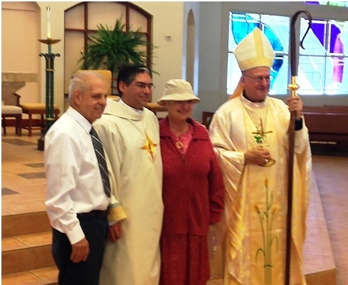 Deacon Joseph Poulin LC with his father and mother and the Bishop.