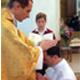 Mons. Nicolas Brouwet impone las manos a H. Adrián González, L.C.