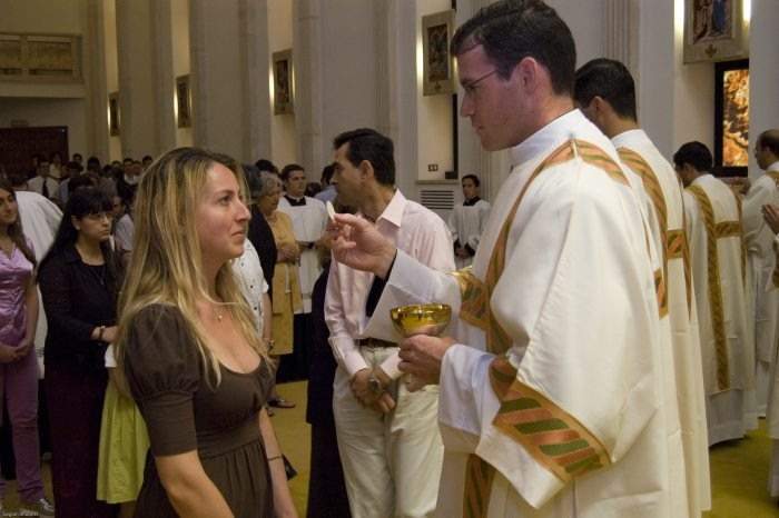 Fr. Thomas gives Communion to his sister-in-law on the day of his ordination to the diaconate, June 30, 2009.