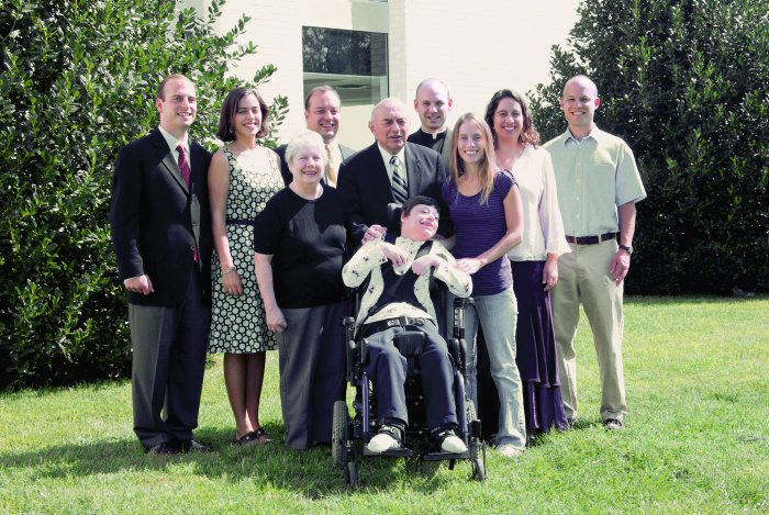 Fr. Thomas with his parents and his three brothers and four sisters in a family reunion.