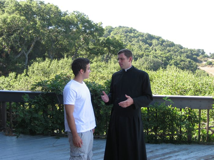 Fr. Joshua gives spiritual guidance as part of his youth work.